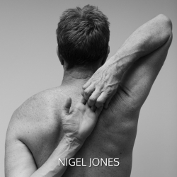 Nigel Jones, co-founder of Yoga Junction with his hands clasped behind his back diagonally