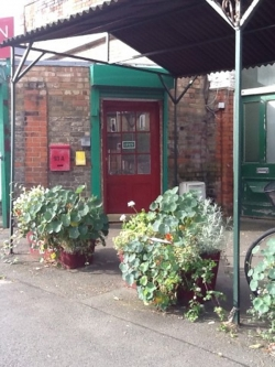 Yoga Junction Centre-Red Front Door with flower troughs in front